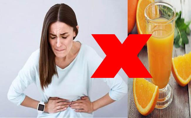 Người đau dạ dày nên tránh uống nước cam