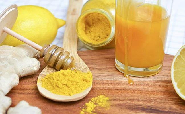Uống nước nghệ mật ong giúp giảm đau dạ dày hiệu quả